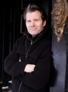 "DAVID LE/Staff Photo. Eagle-Tribune. Local author Andre Dubus III stands outside the Tap Restaurant on Washington St. in downtown Haverhill. Dubus' new book ""Townie-A Memoir,"" focuses on Dubus' childhood and growing up in Haverhill. 1/28/11."